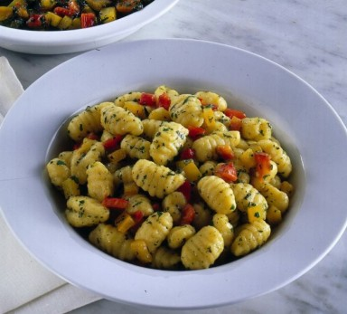 Potato gnocchi with red onions and peppers